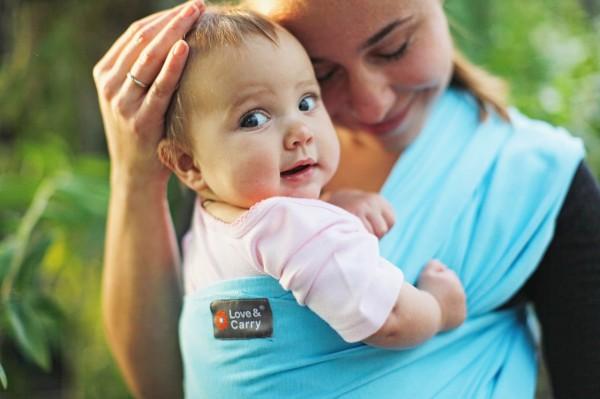 Слинги для удобства женщины с младенцем: распространение аксессуара
