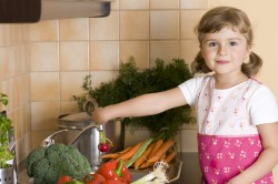 Little girl helping in kitchen