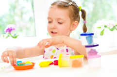 http://www.dreamstime.com/stock-photos-child-playing-colorful-dough-cute-little-girl-play-image33545923